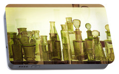 Portable Battery Charger featuring the photograph Bottled Light by Holly Kempe