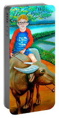 Boy Riding A Carabao Portable Battery Charger by Lorna Maza