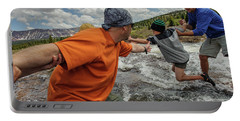 Boys Cross A Stream In The Alpine Portable Battery Charger