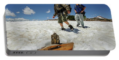 Boys Hike Across Snow Below Tungsten Portable Battery Charger