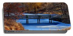 Portable Battery Charger featuring the photograph Bridge Over Icy Waters by Elizabeth Winter
