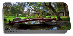 Portable Battery Charger featuring the photograph Bridge Over Japanese Gardens Tea House by Jerry Cowart