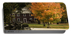 Portable Battery Charger featuring the photograph Bright Orange Autumn by Jeff Folger