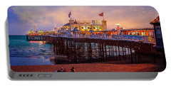 Portable Battery Charger featuring the photograph Brighton's Palace Pier At Dusk by Chris Lord