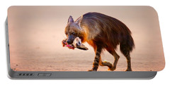 Brown Hyena With Bat-eared Fox In Jaws Portable Battery Charger