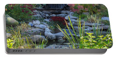Portable Battery Charger featuring the photograph Buddha Water Pond by Brenda Brown
