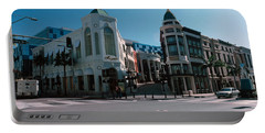 Buildings Along The Road, Rodeo Drive Portable Battery Charger by Panoramic Images