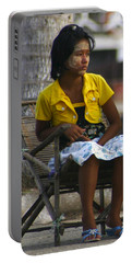Burmese Girl With Traditional Thanaka Face Painting Sitting On Chair Yangon Myanmar Portable Battery Charger