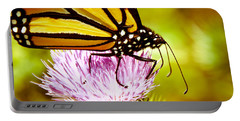 Portable Battery Charger featuring the photograph Busy Butterfly by Cheryl Baxter