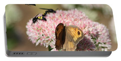 Portable Battery Charger featuring the photograph Busy Days by Rogerio Mariani