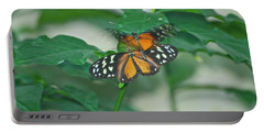 Portable Battery Charger featuring the photograph Butterflies Gentle Touch by Thomas Woolworth