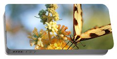 Portable Battery Charger featuring the photograph Butterfly At Work by Trina  Ansel