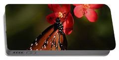 Butterfly On Red Blossom Portable Battery Charger