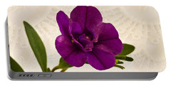 Portable Battery Charger featuring the photograph Calibrachea Petunia Blossom Macro  by Sandra Foster
