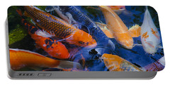 Portable Battery Charger featuring the photograph Calm Koi Fish by Jerry Cowart