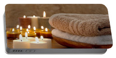 Candles And Towels In A Spa Portable Battery Charger