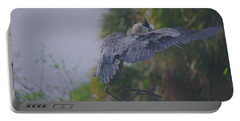 Portable Battery Charger featuring the photograph Careful Landing by Dennis Baswell