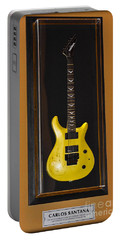 Portable Battery Charger featuring the photograph Carlos Santana's Guitar by Gary Keesler