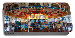 Portable Battery Charger featuring the photograph Carousel Ride by Jerry Cowart
