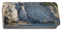 Portable Battery Charger featuring the photograph Cave By The Sea by George Katechis