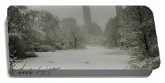 Portable Battery Charger featuring the photograph Central Park Snowstorm by Chris Lord