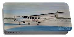 Portable Battery Charger featuring the painting Cessna 208 Caravan by Marilyn  McNish