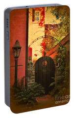 Portable Battery Charger featuring the photograph Charleston Garden Entrance by Kathy Baccari
