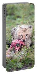 Cheetah Cub Acinonyx Jubatus Eating Portable Battery Charger