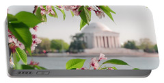 Portable Battery Charger featuring the photograph Cherry Blossoms And The Jefferson Memorial by Mitchell R Grosky