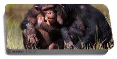 Chimpanzees Eating A Carrot Portable Battery Charger by Nick  Biemans