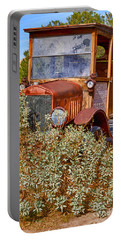 Portable Battery Charger featuring the photograph China Ranch Truck by Jerry Fornarotto
