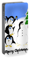 Portable Battery Charger featuring the digital art Christmas Penguins by Stephanie Grant