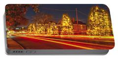 Portable Battery Charger featuring the photograph Christmas Town Usa by Alex Grichenko