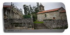 Church And Cemetery In A Small Village In Galicia Portable Battery Charger