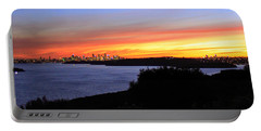 Portable Battery Charger featuring the photograph City Lights In The Sunset by Miroslava Jurcik