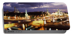 City Lit Up At Night, Red Square Portable Battery Charger