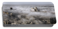 Portable Battery Charger featuring the photograph City Skyscrapers Above The Clouds by Ron Shoshani