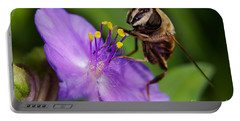Closeup Of A Bee On A Purple Flower Portable Battery Charger