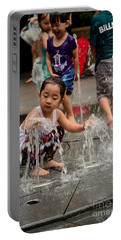 Clothed Children Play At Water Fountain Portable Battery Charger