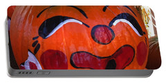 Portable Battery Charger featuring the photograph Clown Pumpkin by Denyse Duhaime