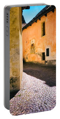 Portable Battery Charger featuring the photograph Cobbled Street by Silvia Ganora
