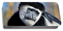 Portable Battery Charger featuring the photograph Colobus Contemplation by Deena Stoddard
