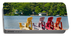 Portable Battery Charger featuring the photograph Colorful Chairs by Les Palenik