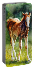 Portable Battery Charger featuring the painting Colt In Green Pastures by Bonnie Rinier