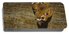 Common Buckeye With Torn Wing Portable Battery Charger by Lynn Palmer