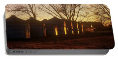 Portable Battery Charger featuring the photograph Corn Cribs At Sunset by Rodney Lee Williams