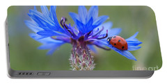 Portable Battery Charger featuring the photograph Cornflower Ladybug Siebenpunkt Blue Red Flower by Paul Fearn