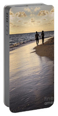 Couple Walking On A Beach Portable Battery Charger