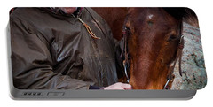 Portable Battery Charger featuring the photograph Cowboy And His Horse by Steven Reed