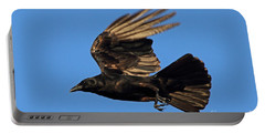 Portable Battery Charger featuring the photograph Crow In Flight by Meg Rousher